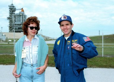 STS-87 Payload Specialist Leonid Kadenyuk of the National Space Agency of Ukraine poses with his wife, Vera Kadenyuk, in front of Kennedy Space Center's Launch Pad 39B during final prelaunch activities leading up to the scheduled Nov. 19 liftoff. The other STS-87 crew members are Commander Kevin Kregel; Pilot Steven Lindsey; and Mission Specialists Kalpana Chawla, Ph.D.; Winston Scott; and Takao Doi, Ph.D., National Space Development Agency of Japan. STS-87 will be the fourth flight of the United States Microgravity Payload and the Spartan-201 deployable satellite