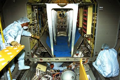 The Neurolab payload for STS-90, scheduled to launch aboard the Shuttle Columbia from Kennedy Space Center (KSC) on April 2, 1998, is installed in the Spacelab module by Boeing technicians in the Operations and Checkout Building at KSC. Investigations during the Neurolab mission will focus on the effects of microgravity on the nervous system. Specifically, experiments will study the adaptation of the vestibular system, the central nervous system, and the pathways that control the ability to sense location in the absence of gravity, as well as the effect of microgravity on a developing nervous system. The crew of STS-90 will include Commander Richard Searfoss, Pilot Scott Altman, Mission Specialists Richard Linnehan, Dafydd (Dave) Williams, M.D., and Kathryn (Kay) Hire, and Payload Specialists Jay Buckey, M.D., and James Pawelczyk, Ph.D