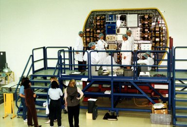 KENNEDY SPACE CENTER, FLA. -- STS-89 crew members and technicians participate in the Crew Equipment Interface Test (CEIT) in front of the back cap of the SPACEHAB module at the SPACEHAB Payload Processing Facility at Port Canaveral in preparation for the mission, slated to be the first Shuttle launch of 1998. The CEIT gives astronauts an opportunity to get a hands-on look at the payloads with which they will be working onorbit. STS-89 will be the eighth of nine scheduled Mir dockings and will include a double module of SPACEHAB, used mainly as a large pressurized cargo container for science, logistical equipment and supplies to be exchanged between the orbiter Endeavour and the Russian Space Station Mir. The nine-day flight of STS-89 also is scheduled to include the transfer of the seventh American to live and work aboard the Russian orbiting outpost. Liftoff of Endeavour and its seven-member crew is targeted for Jan. 15, 1998, at 1:03 a.m. EDT from Launch Pad 39A
