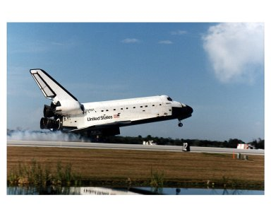 """KENNEDY SPACE CENTER, FLA. -- The Space Shuttle orbiter Atlantis touches down on Runway 33 at 9:22:44 a.m. EST Jan. 22 to conclude the fifth Shuttle-Mir docking mission and return NASA astronaut John Blaha to Earth after four months in space. Blaha was replaced by STS-81 Mission Specialist Jerry Linenger during the five days of docked operations. At main gear touchdown, the STS-81 mission duration was 10 days, 4 hours, 55 minutes. This was the 34th KSC landing in Shuttle history. Mission Commander Michael A. Baker flew Atlantis to a perfect landing, with help from Pilot Brent W. Jett, Jr. Other returning STS-81 crew members are Mission Specialists John M. Grunsfeld, Peter J. K. """"Jeff"""" Wisoff and Marsha S. Ivins. Atlantis also brought back experiment samples from the Russian space station for analysis on Earth, along with Russian logistics equipment"""