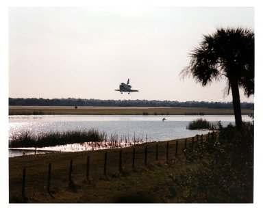 """KENNEDY SPACE CENTER, FLA. -- The Space Shuttle orbiter Atlantis glides out of a morning sky as it prepares to land on Runway 33 at a scheduled time of about 9:23 a.m. EST Jan. 22 to conclude the fifth Shuttle-Mir docking mission and return NASA astronaut John Blaha to Earth after four months in space. At main gear touchdown, the STS-81 mission duration will be 10 days, 4 hours, 55 minutes. This is the 34th KSC landing in Shuttle history. Mission Commander Michael A. Baker is steering Atlantis to a perfect landing, with help from Pilot Brent W. Jett, Jr. Other returning STS-81 crew members are Mission Specialists John M. Grunsfeld, Peter J. K. """"Jeff"""" Wisoff and Marsha S. Ivins. Atlantis also brought back experiment samples from the Russian space station Mir for analysis on Earth"""