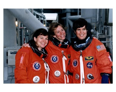 """STS-83 Alternate Mission Specialist Catherine """"Cady"""" Coleman, Pilot Susan L. Still and Payload Commander Janice Voss mug for the camera at the 195-foot level of Launch Pad 39A during Terminal Countdown Demonstration Test (TCDT) exercises for that mission. The other crew members for the 16-day Microgravity Science Laboratory-1 (MSL-1) mission are Mission Commander James D. Halsell, Jr.; Mission Specialist Donald A. Thomas; Payload Specialist Gregory T. Linteris; Mission Specialist Michael L. Gernhardt; and Payload Specialist Roger K. Crouch"""