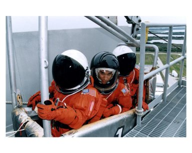 Three members of the STS-83 flight crew check out one of the baskets for the emergency egress slidewire system at Launch Pad 39A during Terminal Countdown Demonstration Test (TCDT) exercises for that mission. Payload Specialist Gregory T. Linteris is in the center of the group. Other crew members on the 16-day Microgravity Science Laboratory-1 (MSL-1) mission are: Mission Commander James D. Halsell, Jr.; Pilot Susan L. Still; Payload Commander Janice Voss; Mission Specialists Michael L. Gernhardt and Donald A. Thomas; and Payload Specialist Roger K. Crouch