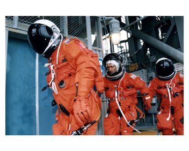 Three members of the STS-83 flight crew head toward the orbiter access arm on the 195-foot level Launch of Pad 39A that will take them to the crew hatch of the Space Shuttle Columbia during Terminal Countdown Demonstration Test (TCDT) exercises for that mission. Mission Specialist Donald A. Thomas is in the center of the group. Other crew members on the 16-day Microgravity Science Laboratory-1 (MSL-1) mission are: Mission Commander James D. Halsell, Jr.; Pilot Susan L. Still; Payload Commander Janice Voss; Mission Specialist Michael L.Gernhardt; and Payload Specialists Gregory T. Linteris and Roger K. Crouch