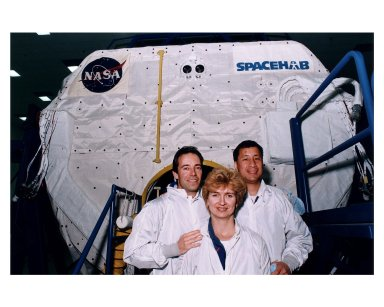 STS-84 crew members pose outside the SPACEHAB Double Module, which will carry more than 6,000 pounds of scientific experiments and logistics to the Russian Space Station Mir. From left, are Mission Specialists Jean-Francois Clervoy of the European Space Agency, Elena V. Kondakova of the Russian Space Agency, and Edward Tsang Lu of NASA. They are participating in the Crew Equipment Integration Test (CEIT) at the SPACEHAB Payload Processing Facility in Cape Canaveral. STS-84 will be the sixth docking of the Space Shuttle with Mir. It also will be the third consecutive crew member exchange of U.S. astronauts aboard Mir. STS-84 Mission Specialist C. Michael Foale will replace astronaut Jerry M. Linenger on Mir. Linenger has been on Mir since the STS-81 mission in January. Foale is scheduled to remain on Mir about four months. STS-84 is targeted for a May 15 liftoff