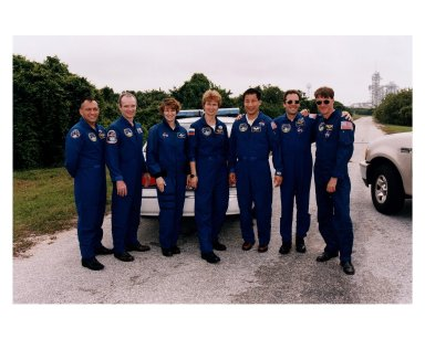 STS-84 crew members pose for a group photograph in the Launch Complex 39 area with Launch Pad A in the background. The seven crew members are scheduled to lift off next month from Pad A aboard the Space Shuttle Atlantis on a scheduled nine-day mission. From left, are Mission Specialist Carlos I. Noriega, Commander Charles J. Precourt, Pilot Eileen Marie Collins, Russian cosmonaut and STS-84 Mission Specialist Elena V. Kondakova, Mission Specialist Edward Tsang Lu, European Space Agency astronaut and STS-84 Mission Specialist Jean-Francois Clervoy, and Mission Specialist C. Michael Foale. They are at KSC to participate in the Terminal Countdown Demonstration Test (TCDT), a dress rehearsal for launch. Foale will be dropped off on Mir to become a member of the Mir 23 crew, replacing U.S. astronaut Jerry M. Linenger, who will return to Earth on Atlantis after about four months on the orbiting station. STS-84 will be the sixth Shuttle-Mir docking. Liftoff is targeted for May 15