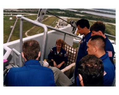 With several of her fellow crew members watching, STS-84 Mission Specialist Elena V. Kondakova, seated at center, gets instructions on using the slidewire baskets, part of the emergency egress system at Launch Pad 39A. Familiarization with pad procedures and systems is part of the Terminal Countdown Demonstration Test (TCDT) activities for the crew. Kondakova, a cosmonaut with the Russian space agency, is one of the seven STS-84 crew members for the sixth docking of the Space Shuttle with the Russian Space Station Mir. Another member, C. Michael Foale, will transfer to the space station and become a member of the Mir 23 crew, replacing U.S. astronaut Jerry M. Linenger, who will return to Earth aboard Atlantis. Foale will live and work on Mir until mid-September when his replacement is expected to arrive on the STS-86 mission. Kondakova previously lived on the Russian space station as the flight engineer of the 17th main mission on Mir from Oct. 4, 1994, to March 9, 1995. STS-84 is targeted for a May 15 liftoff