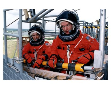 STS-84 Commander Charles J. Precourt, at right, and Pilot Eileen Marie Collins practice emergency egress procedures in a slidewire basket at Launch Pad 39A. They and the other five members of the STS-84 crew are participating in the Terminal Countdown Demonstration Test (TCDT), a dress rehearsal for launch. STS-84 aboard Atlantis will be the sixth docking of the Space Shuttle with the Russian Space Station Mir. After docking, STS-84 Mission Specialist C. Michael Foale will transfer to the space station and become a member of the Mir 23 crew, replacing U.S. astronaut Jerry M. Linenger, who will return to Earth aboard Atlantis. Foale will live and work on Mir until mid-September when his replacement is expected to arrive on the STS-86 mission. STS-84 is targeted for a May 15 liftoff