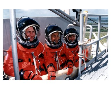 STS-84 Mission Specialists, from left, C. Michael Foale, Edward Tsang Lu and Elena V. Kondakova practice emergency egress procedures in a slidewire basket at Launch Pad 39A. They and the other four members of the STS-84 crew are participating in the Terminal Countdown Demonstration Test (TCDT), a dress rehearsal for launch. STS-84 aboard Atlantis will be the sixth docking of the Space Shuttle with the Russian Space Station Mir. After docking, Foale will transfer to the space station and become a member of the Mir 23 crew, replacing U.S. astronaut Jerry M. Linenger, who will return to Earth aboard Atlantis. Foale will live and work on Mir until mid-September when his replacement is expected to arrive on the STS-86 mission. STS-84 is targeted for a May 15 liftoff