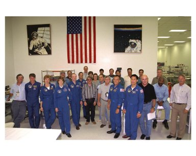 The STS-84 crew pose for a photograph with members of the mission payload team in the Space Station Processing Facility. Dressed in their blue flight suits, from left, are Mission Specialist C. Michael Foale, Elena V. Kondakova of the Russian Space Agency, Pilot Eileen Marie Collins, Commander Charles J. Precourt, Mission Specialist Jean-Francois Clervoy of the European Space Agency, Mission Specialist Carlos I. Noriega and Mission Specialist Edward Tsang Lu. STS-84 aboard the Space Shuttle Atlantis will be the sixth docking of the Space Shuttle with the Russian Space Station Mir. After docking, Foale will transfer to the space station and become a member of the Mir 23 crew, replacing U.S. astronaut Jerry M. Linenger, who will return to Earth aboard Atlantis. Foale will live and work on Mir until mid-September when his replacement is expected to arrive on the STS-86 mission. STS-84 is targeted for a May 15 liftoff