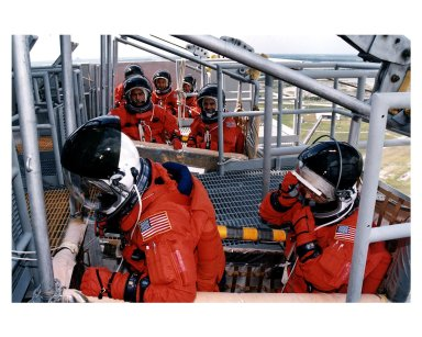 STS-84 crew members practice emergency egress procedures in slidewire baskets at Launch Pad 39A. They are participating in the Terminal Countdown Demonstration Test (TCDT), a dress rehearsal for launch. In the foreground are Commander Charles J. Precourt, at left, and Pilot Eileen Marie Collins. In the middle basket are Mission Specialists Carlos I. Noriega, at left, and Jean-Francois Clervoy of the European Space Agency. In the last slidewire basket at rear, from left, are Mission Specialists C. Michael Foale, Edward Tsang Lu and Elena V. Kondakova of the Russian Space Agency. STS-84 aboard Atlantis will be the sixth docking of the Space Shuttle with the Russian Space Station Mir. After docking, Foale will transfer to the space station and become a member of the Mir 23 crew, replacing U.S. astronaut Jerry M. Linenger, who will return to Earth aboard Atlantis. Foale will live and work on Mir until mid-September when his replacement is expected to arrive on the STS-86 mission. STS-84 is targeted for a May 15 liftoff