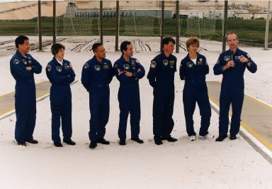 STS-84 crew members listen intently to Commander Charles J. Precourt, at far right, as he talks to news media representatives and other onlookers at Launch Pad 39A during the Terminal Countdown Demonstration Test (TCDT). Other crew members, from left, are Mission Specialist Edward Tsang Lu, Pilot Eileen Marie Collins, and Mission Specialists Carlos I. Noriega, Jean-Francois Clervoy of the European Space Agency, C. Michael Foale, and Elena V. Kondakova of the Russian Space Agency. STS-84 will be the sixth docking of the Space Shuttle with the Russian Space Station Mir. After docking, Foale will transfer to the space station and become a member of the Mir 23 crew, replacing U.S. astronaut Jerry M. Linenger, who will return to Earth aboard Atlantis. Foale will live and work on Mir until mid-September when his replacement is expected to arrive on the STS-86 mission. STS-84 is targeted for a May 15 liftoff