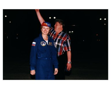 STS-84 Mission Specialist Elena V. Kondakova, a cosmonaut with the Russian Space Agency, and her husband, Valery Ryumin, greet press represenatives and other well wishers after her arrival at KSC?s Shuttle Landing Facility. Ryumin is director of the Mir-Shuttle program for RSC Energia in Russia. This will be Kondakova?s first flight on a U.S. Space Shuttle, but her second trip into space. She spent 169 days in space as flight engineer of the 17th main mission on Mir from October 1994 to March 1995. STS-84 will be the sixth docking of the Space Shuttle with the Russian Space Station Mir. During the docking, STS-84 Mission Specialist C. Michael Foale will transfer to the Russian space station to become a member of the Mir 23 crew, replacing U.S. astronaut Jerry M. Linenger, who will return to Earth on Atlantis. Foale is scheduled to remain on Mir about four months until his replacement arrives on STS-86 in September