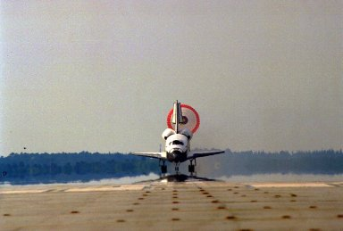 The orbiter drag chute deploys after Atlantis touches down on Runway 33 of KSC?s Shuttle Landing Facility at the conclusion of the nine-day STS-84 mission. Main gear touchdown was at 9:27:44 EDT on May 24, 1997. The first landing opportunity was waved off because of low cloud cover. It was the 37th landing at KSC since the Shuttle program began in 1981, and the eighth consecutive landing at KSC. STS-84 was the sixth of nine planned dockings of the Space Shuttle with the Russian Space Station Mir. Atlantis was docked with the Mir for five days. STS-84 Mission Specialist C. Michael Foale replaced astronaut and Mir 23 crew member Jerry M. Linenger, who has been on the Russian space station since Jan. 15. Linenger returned to Earth on Atlantis with the rest of the STS-84 crew, Mission Commander Charles J. Precourt, Pilot Eileen Marie Collins, and Mission Specialists Carlos I. Noriega, Edward Tsang Lu, Elena V. Kondakova of the Russian Space Agency and JeanFrancois Clervoy of the European Space Agency. Foale is scheduled to remain on the Mir for approximately four months, until he is replaced by STS-86 crew member Wendy B. Lawrence in September. Besides the docking and crew exchange, STS-84 included the transfer of more than 7,300 pounds of water, logistics and science experiments and hardware to and from the Mir. Scientific experiments conducted during the STS-84 mission, and scheduled for Foale?s stay on the Mir, are in the fields of advanced technology, Earth sciences, fundamental biology, human life sciences, International Space Station risk mitigation, microgravity sciences and space sciences