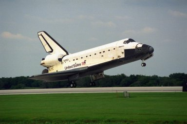 The Space Shuttle orbiter Atlantis touches down on Runway 33 of the KSC Shuttle Landing Facility, bringing to an end the nine-day STS-84 mission. Main gear touchdown was at 9:27:44 EDT on May 24, 1997. The first landing opportunity was waved off because of low cloud cover. It was the 37th landing at KSC since the Shuttle program began in 1981, and the eighth consecutive landing at KSC. STS-84 was the sixth of nine planned dockings of the Space Shuttle with the Russian Space Station Mir. Atlantis was docked with the Mir for five days. STS-84 Mission Specialist C. Michael Foale replaced astronaut and Mir 23 crew member Jerry M. Linenger, who has been on the Russian space station since Jan. 15. Linenger returned to Earth on Atlantis with the rest of the STS-84 crew, Mission Commander Charles J. Precourt, Pilot Eileen Marie Collins, and Mission Specialists Carlos I. Noriega, Edward Tsang Lu, Elena V. Kondakova of the Russian Space Agency and JeanFrancois Clervoy of the European Space Agency. Foale is scheduled to remain on the Mir for approximately four months, until he is replaced by STS-86 crew member Wendy B. Lawrence in September. Besides the docking and crew exchange, STS-84 included the transfer of more than 7,300 pounds of water, logistics and science experiments and hardware to and from the Mir. Scientific experiments conducted during the STS-84 mission, and scheduled for Foale?s stay on the Mir, are in the fields of advanced technology, Earth sciences, fundamental biology, human life sciences, International Space Station risk mitigation, microgravity sciences and space sciences