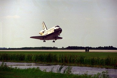 The Space Shuttle orbiter Atlantis glides in for a landing on Runway 33 at KSC?s Shuttle Landing Facility at the conclusion of the nine-day STS-84 mission. It will be the 37th landing at KSC since the Shuttle program began in 1981, and the eighth consecutive landing at KSC. STS-84 was the sixth of nine planned dockings of the Space Shuttle with the Russian Space Station Mir. Atlantis was docked with the Mir for five days. STS-84 Mission Specialist C. Michael Foale replaced astronaut and Mir 23 crew member Jerry M. Linenger, who has been on the Russian space station since Jan. 15. Linenger returned to Earth on Atlantis with the rest of the STS-84 crew, Mission Commander Charles J. Precourt, Pilot Eileen Marie Collins, and Mission Specialists Carlos I. Noriega, Edward Tsang Lu, Elena V. Kondakova of the Russian Space Agency and Jean-Francois Clervoy of the European Space Agency. Foale is scheduled to remain on the Mir for approximately four months, until he is replaced by STS-86 crew member Wendy B. Lawrence in September. Besides the docking and crew exchange, STS-84 included the transfer of more than 7,300 pounds of water, logistics and science experiments and hardware to and from the Mir. Scientific experiments conducted during the STS-84 mission, and scheduled for Foale?s stay on the Mir, are in the fields of advanced technology, Earth sciences, fundamental biology, human life sciences, International Space Station risk mitigation, microgravity sciences and space sciences