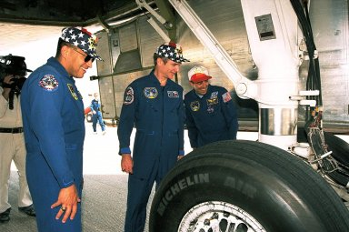 STS-84 crew members, from left, Mission Specialist Carlos I. Noriega, Commander Charles J. Precourt and Mission Specialist Jean-Francois Clervoy examine the tires of the Space Shuttle Atlantis after landing. Atlantis traveled about 3.6 million miles during the nine-day mission, which was the sixth of nine planned dockings of the Space Shuttle with the Russian Space Station Mir. The mission also included the exchange of STS-84 Mission Specialist C. Michael Foale for astronaut and Mir 23 crew member, Jerry M. Linenger, who spent the last four months on the Russian space station