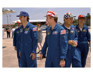 KENNEDY SPACE CENTER, FLA. - Members of the STS-84 crew pause at Patrick Air force Base just prior to their departure for Johnson Space Center in Houston, Texas. They are (from left) Mission Specialist Jean-Francois Clervoy; returning astronaut and Mir 23 crew member Jerry M. Linenger; Mission Commander Charles J. Precourt; Mission Specialist Edward Tsang Lu; and Mission Specialist Elena V. Kondakova. The seven-member crew returned aboard the Space Shuttle Orbiter Atlantis May 24 on KSC's Runway 33 after the completion of a successful nine-day mission. STS-84 was the sixth docking of the Space Shuttle with the Russian Space Station MIr. Atlantis was docked with the Mir for five days. STS-84 Mission Specialist C. Michael Foale replaced Linenger, who had been on the Russian space station since Jan. 15. Besides the docking and crew exchange, STS-84 included the transfer of more than 7,300 pounds of water, logistics and science experiments and hardware to and from the Mir. Scientific experiments conducted during the STS-84 mission, and scheduled for Foale's stay on the Mir, are in the fields of advanced technology, Earth sciences, fundamental biology, human life sciences, International Space Station risk mitigation, microgravity sciences and space sciences.