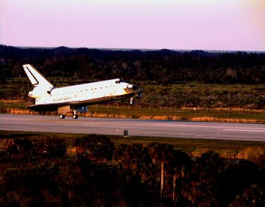 KENNEDY SPACE CENTER, FLA. -- The Space Shuttle orbiter Endeavour touches down on Runway 15 of the KSC Shuttle Landing Facility (SLF) to complete the nearly nine-day STS-89 mission. Main gear touchdown was at 5:35:09 p.m. EST on Jan. 31, 1998. The wheels stopped at 5:36:19 EST, completing a total mission time of eight days, 19 hours, 48 minutes and four seconds. The 89th Space Shuttle mission was the 42nd (and 13th consecutive) landing of the orbiter at KSC, and STS-89 was the eighth of nine planned dockings of the Space Shuttle with the Russian Space Station Mir. STS-89 Mission Specialist Andrew Thomas, Ph.D., succeeded NASA astronaut and Mir 24 crew member David Wolf, M.D., who was on the Russian space station since late September 1997. Dr. Wolf returned to Earth on Endeavour with the remainder of the STS-89 crew, including Commander Terrence Wilcutt; Pilot Joe Edwards Jr.; and Mission Specialists James Reilly, Ph.D.; Michael Anderson; Bonnie Dunbar, Ph.D.; and Salizhan Sharipov with the Russian Space Agency. Dr. Thomas is scheduled to remain on Mir until the STS-91 Shuttle mission returns in June 1998. In addition to the docking and crew exchange, STS-89 included the transfer of science, logistical equipment and supplies between the two orbiting spacecrafts.