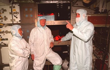 (Left to right) STS-95 Payload Specialists Chiaki Mukai, with the National Space Development Agency of Japan, and John H. Glenn Jr., senator from Ohio, and Mission Commander Curtis L. Brown Jr. take part in middeck orientation during a Crew Equipment Interface Test (CEIT) in the Orbiter Processing Facility Bay 2. The CEIT gives astronauts an opportunity for a hands-on look at the payloads on which they will be working on orbit. The launch of the STS-95 mission, aboard Space Shuttle Discovery, is scheduled for Oct. 29, 1998. The mission includes research payloads such as the Spartan solar-observing deployable spacecraft, the Hubble Space Telescope Orbital Systems Test Platform, the International Extreme Ultraviolet Hitchhiker, as well as the SPACEHAB single module with experiments on space flight and the aging process