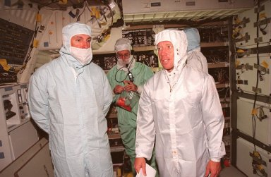 STS-95 Mission Commander Curtis L. Brown Jr. (left) and Pilot Steven Lindsey (right) are in Discovery's midbody checking electrical connections during a Crew Equipment Interface Test (CEIT) for their mission. The CEIT gives astronauts an opportunity for a hands-on look at the payloads on which they will be working on orbit. The launch of the STS-95 mission, aboard Space Shuttle Discovery, is scheduled for Oct. 29, 1998. The mission includes research payloads such as the Spartan solar-observing deployable spacecraft, the Hubble Space Telescope Orbital Systems Test Platform, the International Extreme Ultraviolet Hitchhiker, as well as the SPACEHAB single module with experiments on space flight and the aging process