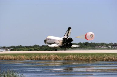 KENNEDY SPACE CENTER, FLA. -- The orbiter Columbia touches down on Runway 33 of KSC's Shuttle Landing Facility to complete the nearly 16-day STS-90 mission. Main gear touchdown was at 12:08:59 p.m. EDT on May 3, 1998, landing on orbit 256 of the mission. The wheels stopped at 12:09:58 EDT, completing a total mission time of 15 days, 21 hours, 50 minutes and 58 seconds. The 90th Shuttle mission was Columbia's 13th landing at the space center and the 43rd KSC landing in the history of the Space Shuttle program. During the mission, the crew conducted research to contribute to a better understanding of the human nervous system. The crew of the STS-90 Neurolab mission include Commander Richard Searfoss; Pilot Scott Altman; Mission Specialists Richard Linnehan, D.V.M., Dafydd (Dave) Williams, M.D., with the Canadian Space Agency, and Kathryn (Kay) Hire; and Payload Specialists Jay Buckey, M.D., and James Pawelczyk, Ph.D