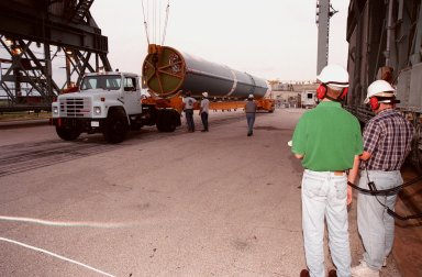 The first stage of Boeing's Delta 7326 rocket, which will be used to launch the Deep Space 1 spacecraft, arrives at Pad 17A at Cape Canaveral Air Station. Targeted for launch on Oct. 15, 1998, this first flight in NASA's New Millennium Program is designed to validate 12 new technologies for scientific space missions of the next century. Onboard experiments include an ion propulsion engine and software that tracks celestial bodies so the spacecraft can make its own navigation decisions without the intervention of ground controllers. Deep Space 1 will complete most of its mission objectives within the first two months but will also do a flyby of a near-Earth asteroid, 1992 KD, in July 1999
