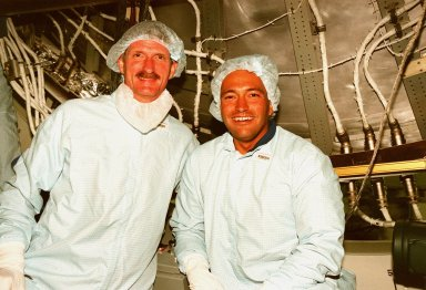 Inside the Space Station Processing Facility, STS-97 Mission Specialists Joseph R. Tanner and Carlos I. Noriega take a break from equipment check for the International Space Station . STS-97, the fourth ISS flight, is targeted to launch on Aug. 5, 1999. It is scheduled to carry integrated truss structure P6, photovoltaic module and radiators