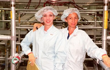 Ursula Stockdale (left), Mod Cargo Operations, and STS-98 Mission Specialist Marsha Ivins, take a break from equipment check in the Space Station Processing Facility. STS-98 is scheduled to carry the U.S. laboratory module, the centerpiece ISS, where unprecedented science experiments will be performed in the near zero gravity of space. The launch is targeted for October 1999 aboard the Space Shuttle Endeavour