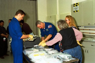 STS-90 Payload Specialists James Pawelczyk, Ph.D. (at left), and Jay Buckey Jr., M.D., examine items to be used during the Crew Equipment Interface Test (CEIT) in Kennedy Space Center's (KSC's) Operations and Checkout Building, where the Neurolab payload is undergoing processing. The CEIT gives astronauts an opportunity to get a hands-on look at the payloads with which they will be working on-orbit. STS-90 is scheduled to launch aboard the Shuttle Columbia from KSC on April 2. Investigations during the Neurolab mission will focus on the effects of microgravity on the nervous system. Specifically, experiments will study the adaptation of the vestibular system, the central nervous system, and the pathways that control the ability to sense location in the absence of gravity, as well as the effect of microgravity on a developing nervous system