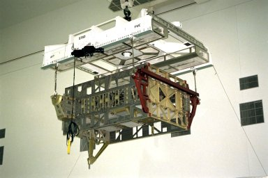 The Photovoltaic Module 1 Integrated Equipment Assembly (IEA) is moved through Kennedy Space Center?s Space Station Processing Facility (SSPF) toward the workstand where it will be processed for flight on STS-97, scheduled for launch in April 1999. The IEA is one of four integral units designed to generate, distribute, and store power for the International Space Station. It will carry solar arrays, power storage batteries, power control units, and a thermal control system. The 16-foot-long, 16,850-pound unit is now undergoing preflight preparations in the SSPF