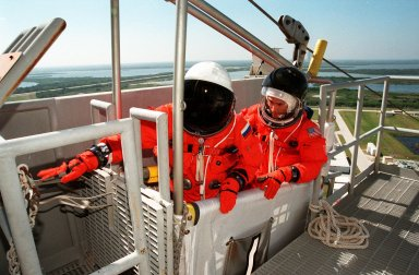 KENNEDY SPACE CENTER, Fla. -- STS-88 Mission Specialists Sergei Konstantinovich Krikalev (left) and James H. Newman (right) are ready to leave Launch Pad 39A in the slidewire basket during an emergency egress exercise. The crew are at KSC to participate in the Terminal Countdown Demonstration Test (TCDT) which includes mission familiarization activities, emergency egress training, and the simulated main engine cut-off exercise. Mission STS-88 is targeted for launch on Dec. 3, 1998. It is the first U.S. flight for the assembly of the International Space Station and will carry the Unity connecting module. Unity will be mated with the already orbiting Russian-built Zarya control module. The 12-day mission includes three planned spacewalks to connect power, data and utility lines and install exterior equipment