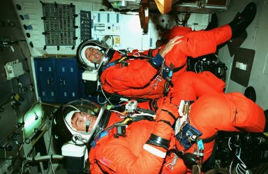 STS-88 Mission Specialists Sergei Konstantinovich Krikalev (left) and James H. Newman (right) sit inside orbiter Endeavour during Terminal Countdown Demonstration Activities (TCDT). The TCDT includes mission familiarization activities, emergency egress training, and the simulated main engine cut-off exercise. Mission STS-88 is targeted for launch on Dec. 3, 1998. It is the first U.S. flight for the assembly of the International Space Station and will carry the Unity connecting module. Unity will be mated with the already orbiting Russian-built Zarya control module. The 12-day mission includes three planned spacewalks to connect power, data and utility lines and install exterior equipment