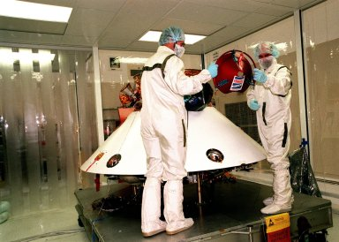 KENNEDY SPACE CENTER, FLA. -- In the Spacecraft Assembly and Encapsulation Facility -2 (SAEF-2), JPL workers prepare to mount a Mars microprobe onto the Mars Polar Lander. Two microprobes will hitchhike on the lander, scheduled to be launched Jan. 3, 1999, aboard a Delta II rocket. The solar-powered spacecraft is designed to touch down on the Martian surface near the northern-most boundary of the south pole in order to study the water cycle there. The lander also will help scientists learn more about climate change and current resources on Mars, studying such things as frost, dust, water vapor and condensates in the Martian atmosphere. The Mars microprobes, called Deep Space 2, are part of NASA's New Millennium Program. They will complement the climate-related scientific focus of the lander by demonstrating an advanced, rugged microlaser system for detecting subsurface water. Such data on polar subsurface water, in the form of ice, should help put limits on scientific projections for the global abundance of water on Mars