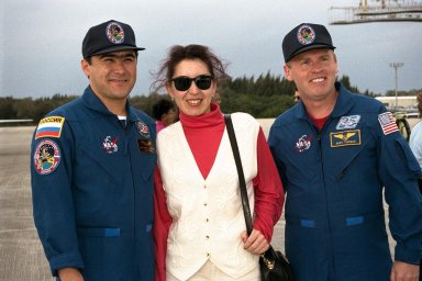 STS-89 Mission Specialist Salizhan Sharipov of the Russian Space Agency, at left, poses with his wife, Nadezhda Sharipova, and Mission Specialist Andrew Thomas, Ph.D., at right, shortly after arrival at the KSC Shuttle Landing Facility. The eight STS-89 crew members flew into KSC from Johnson Space Center as final preparations are under way toward the scheduled liftoff on Jan. 22 of the Space Shuttle Endeavour on the eighth mission to dock with the Russian Space Station Mir. After docking, Dr. Thomas will transfer to the space station, succeeding David Wolf, M.D., who will return to Earth aboard Endeavour. Dr. Thomas will live and work on Mir until June. STS-89 is scheduled for a Jan. 22 liftoff at 9:48 p.m. EST