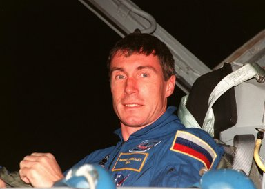 """STS-88 Mission Specialist Sergei Konstantinovich Krikalev, a Russian cosmonaut, smiles at onlookers after his arrival at the Shuttle Landing Facility aboard a T-38 jet aircraft. He joins the five other crew members, Commander Robert D. Cabana, Pilot Frederick W. """"Rick"""" Sturckow and Mission Specialists Nancy J. Currie, Jerry L. Ross and James H. Newman, for prelaunch preparations for Mission STS-88 aboard Space Shuttle Endeavour. The scheduled time of launch is 3:56 a.m. EST on Dec. 3 from Launch Pad 39A. The mission is the first U.S. launch for the International Space Station. Endeavour carries the Unity connecting module which the crew will be mating with the Russian-built Zarya control module already in orbit. In addition to Unity, Endeavour will carry two small replacement electronics boxes for possible repairs to Zarya batteries. The mission is scheduled to last nearly 12 days"""