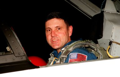 """STS-88 Commander Robert D. Cabana smiles at onlookers after his arrival at the Shuttle Landing Facility aboard a T-38 jet aircraft. He joins other crew members Pilot Frederick W. """"Rick"""" Sturckow and Mission Specialists Nancy J. Currie, Jerry L. Ross, James H. Newman and Sergei Konstantinovich Krikalev, a Russian cosmonaut, for prelaunch preparations for Mission STS-88 aboard Space Shuttle Endeavour. The scheduled time of launch is 3:56 a.m. EST on Dec. 3 from Launch Pad 39A. The mission is the first U.S. launch for the International Space Station. Endeavour carries the Unity connecting module which the crew will be mating with the Russian-built Zarya control module already in orbit. In addition to Unity, Endeavour will carry two small replacement electronics boxes for possible repairs to Zarya batteries. The mission is scheduled to last nearly 12 days"""