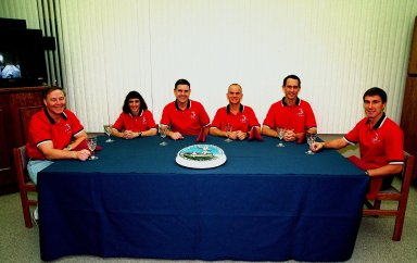 """The STS-88 crew gather for the traditional pre-launch breakfast in the Operations and Checkout Building. From left to right are Mission Specialists Jerry L. Ross and Nancy J. Currie, Commander Robert D. Cabana, Pilot Frederick W. """"Rick"""" Sturckow, and Mission Specialists James H. Newman and Sergei Konstantinovich Krikalev, a Russian cosmonaut. Mission STS-88 is expected to launch at 3:56 a.m. EST aboard Space Shuttle Endeavour on Dec. 3. Endeavour carries the Unity connecting module, which the crew will be mating with the Russian-built Zarya control module already on orbit. In addition to Unity, two small replacement electronics boxes are on board for possible repairs to Zarya batteries. The mission is expected to last 11 days, 19 hours and 49 minutes, landing at 10:17 p.m. EST on Dec. 14"""