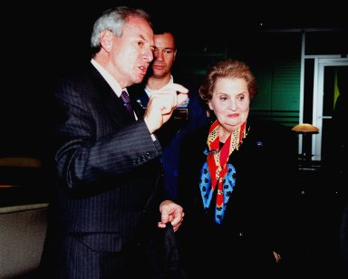 KENNEDY SPACE CENTER, FLA. -- U.S. Secretary of State Madeleine Albright talks with NASA Administrator Daniel Goldin (at left) in the VIP lounge at the Apollo/Saturn V Center while awaiting launch of Mission STS-88, the first U.S. launch for the International Space Station. Astronaut Michael Lopez-Alegria is looking on in background