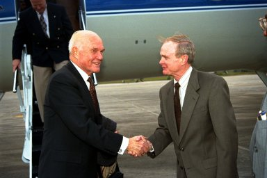 Ohio Senator John Glenn, at left, shakes hands with Kennedy Space Center (KSC) Director Roy Bridges shortly after Glenn's arrival at KSC's Shuttle Landing Facility on Jan. 20 to tour KSC operational areas and to view the launch of STS-89 later this week. Glenn, who made history in 1962 as the first American to orbit the Earth, completing three orbits in a five-hour flight aboard Friendship 7, will fly his second space mission aboard Space Shuttle Discovery this October. Glenn is retiring from the Senate at the end of this year and will be a payload specialist aboard STS-95