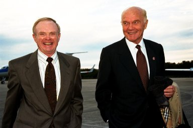 Ohio Senator John Glenn, at right, walks with Kennedy Space Center (KSC) Director Roy Bridges shortly after Glenn's arrival at KSC's Shuttle Landing Facility on Jan. 20 to tour KSC operational areas and to view the launch of STS-89 later this week. Glenn, who made history in 1962 as the first American to orbit the Earth, completing three orbits in a five-hour flight aboard Friendship 7, will fly his second space mission aboard Space Shuttle Discovery this October. Glenn is retiring from the Senate at the end of this year and will be a payload specialist aboard STS-95