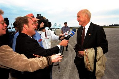 Ohio Senator John Glenn spoke with the media shortly after he arrived at Kennedy Space Center's (KSC's) Shuttle Landing Facility on Jan. 20 to tour KSC operational areas and to view the launch of STS-89 later this week. Glenn, who made history in 1962 as the first American to orbit the Earth, completing three orbits in a five-hour flight aboard Friendship 7, will fly his second space mission aboard Space Shuttle Discovery this October. Glenn is retiring from the Senate at the end of this year and will be a payload specialist aboard STS-95