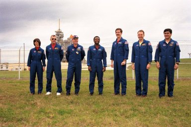 KENNEDY SPACE CENTER, Fla. -- STS-89 Mission Specialist Bonnie Dunbar, Ph.D.; Commander Terrence Wilcutt; Mission Specialists Andrew Thomas, Ph.D., Michael Anderson, James Reilly, Ph.D.; Pilot Joe Edwards Jr.; and Mission Specialist Salizhan Sharipov of the Russian Space Agency pose at KSC's Launch Pad 39A the day before the scheduled launch of Space Shuttle Endeavour. Final preparations are under way toward liftoff on Jan. 22 on the eighth mission to dock with the Russian Space Station Mir. After docking, Dr. Thomas will transfer to the space station, succeeding David Wolf, M.D., who will return to Earth aboard Endeavour. Dr. Thomas will live and work on Mir until June. STS-89 is scheduled for liftoff at 9:48 p.m. EST