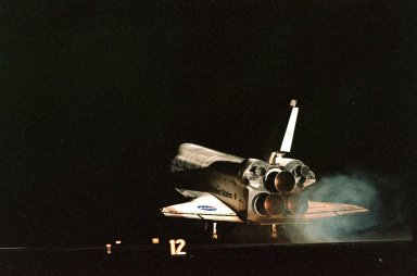 """KENNEDY SPACE CENTER, Fla. -- After a flawless mission, Endeavour touches down at 10:53:29 p.m. EST on Runway 15 at the Shuttle Landing Facility to complete an 11-day, 19-hour and 18-minute-long STS-88 mission. At the controls is Commander Robert D. Cabana. Other crew members on board are Pilot Frederick W. """"Rick"""" Sturckow and Mission Specialists Jerry L. Ross, Nancy J. Currie, James H. Newman and Sergei Konstantinovich Krikalev, a Russian cosmonaut. This is the tenth nighttime landing for a Space Shuttle, the fifth at Kennedy Space Center, and the ninth landing of Endeavour at KSC. On the 4.6-million-mile mission, Endeavour carried the U.S.-built Unity connecting module to begin construction of the International Space Station. The crew successfully mated Unity with the Russian-built Zarya control module during three space walks. With this mission, Ross completed seven space walks totaling 44 hours and 9 minutes, more than any other American space walker. Newman moved into third place for U.S. space walks with a total of 28 hours and 27 minutes on four excursions"""