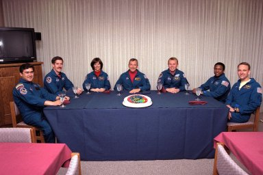 "The STS-89 crew enjoy the traditional pre-liftoff ""breakfast"" in the crew quarters of the Operations and Checkout Building. They are (from left) Mission Specialists Salizhan Sharipov of the Russian Space Agency, James Reilly, Ph.D., Bonnie Dunbar, Ph.D., Commander Terrence Wilcutt, Mission Specialists Andrew Thomas, Ph.D., Michael Anderson, and Pilot Joe Edwards Jr. After a weather briefing, the flight crew will be fitted with their launch/entry suits and depart for Launch Pad 39A. Once there, they will take their positions in the crew cabin of the Space Shuttle Endeavour to await a liftoff during a 10-minute window that will open at 9:43 p.m. EST, Jan. 22"
