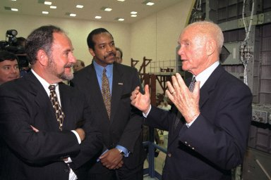 Ohio Senator John Glenn, at right, enjoys a tour of the SPACEHAB Payload Processing Facility in Cape Canaveral. Joining Senator Glenn are, left to right, David Rossi, SPACEHAB president and chief operating officer (extreme left); Michael Lounge, SPACEHAB vice president, flight systems development; and Dr. Bernard Harris, SPACEHAB vice president, microgravity and life sciences. Senator Glenn arrived at KSC on Jan. 20 to tour KSC operational areas and to view the launch of STS-89 later this week. Glenn, who made history in 1962 as the first American to orbit the Earth, completing three orbits in a five-hour flight aboard Friendship 7, will fly his second space mission aboard Space Shuttle Discovery this October. Glenn is retiring from the Senate at the end of this year and will be a payload specialist aboard STS-95
