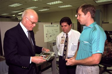Ohio Senator John Glenn, at left, enjoys a tour of the Engineering Development Laboratory at Kennedy Space Center. Standing with Senator Glenn are, left to right, Chief Engineer Hugo Delgado and Design Engineer David Kruhm, both of NASA Advanced Development and Shuttle Upgrades. Senator Glenn arrived at KSC on Jan. 20 to tour KSC operational areas and to view the launch of STS-89. Glenn, who made history in 1962 as the first American to orbit the Earth, completing three orbits in a five-hour flight aboard Friendship 7, will fly his second space mission aboard Space Shuttle Discovery this October. Glenn is retiring from the Senate at the end of this year and will be a payload specialist aboard STS-95