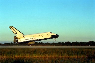 KENNEDY SPACE CENTER, Fla. -- The Space Shuttle orbiter Endeavour touches down on Runway 15 of the KSC Shuttle Landing Facility (SLF) to complete the nearly nine-day STS-89 mission. Main gear touchdown was at 5:35:09 p.m. EST on Jan. 31, 1998. The wheels stopped at 5:36:19 EST, completing a total mission time of eight days, 19 hours, 48 minutes and four seconds. The 89th Space Shuttle mission was the 42nd (and 13th consecutive) landing of the orbiter at KSC, and STS-89 was the eighth of nine planned dockings of the Space Shuttle with the Russian Space Station Mir. STS-89 Mission Specialist Andrew Thomas, Ph.D., succeeded NASA astronaut and Mir 24 crew member David Wolf, M.D., who was on the Russian space station since late September 1997. Dr. Wolf returned to Earth on Endeavour with the remainder of the STS-89 crew, including Commander Terrence Wilcutt; Pilot Joe Edwards Jr.; and Mission Specialists James Reilly, Ph.D.; Michael Anderson; Bonnie Dunbar, Ph.D.; and Salizhan Sharipov with the Russian Space Agency. Dr. Thomas is scheduled to remain on Mir until the STS-91 Shuttle mission returns in June 1998. In addition to the docking and crew exchange, STS-89 included the transfer of science, logistical equipment and supplies between the two orbiting spacecrafts