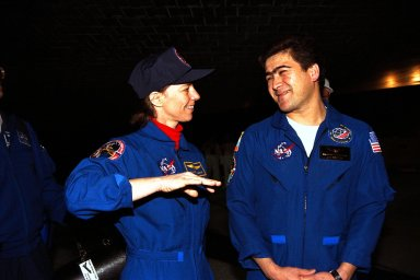 KENNEDY SPACE CENTER, FLA. -- STS-89 Mission Specialist Bonnie Dunbar, Ph.D., at left, discusses the mission with Mission Specialist Salizhan Sharipov of the Russian Space Agency under the orbiter Endeavour after it landed on Runway 15 at KSC?s Shuttle Landing Facility Jan. 31. The 89th Space Shuttle mission was the 42nd (and 13th consecutive) landing of the orbiter at KSC, and STS-89 was the eighth of nine planned dockings of the orbiter with the Russian Space Station Mir. STS-89 Mission Specialist Andrew Thomas, Ph.D., succeeded NASA astronaut and Mir 24 crew member David Wolf, M.D., who was on the Russian space station since late September 1997. Dr. Wolf returned to Earth on Endeavour with the remainder of the STS-89 crew, including Commander Terrence Wilcutt; Pilot Joe Edwards Jr.; and Mission Specialists James Reilly, Ph.D.; Michael Anderson; Dr. Dunbar; and Sharipov. Dr. Thomas is scheduled to remain on Mir until the STS-91 Shuttle mission returns in June 1998. In addition to the docking and crew exchange, STS-89 included the transfer of science, logistical equipment and supplies between the two orbiting spacecrafts