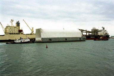 KENNEDY SPACE CENTER, FLA. -- The Space Shuttle's first super lightweight external tank is moved on a barge by two tug boats toward a pier at Port Canaveral, Fla. The tank is scheduled to undergo processing at Kennedy Space Center for flight on STS-91, targeted for launch in late May. The improved tank is 7,500 pounds lighter than its predecessors and was developed to increase the Shuttle payload capacity on International Space Station assembly flights. The tank was sent from the NASA Michoud Assembly Facility in New Orleans